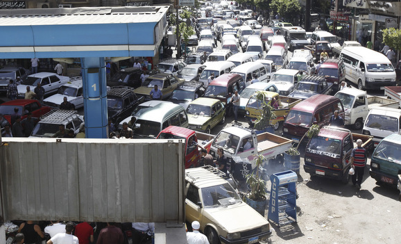 Vehicles queue at a petrol station at a gas and a petrol station during a fuel shortage at the country in Cairo