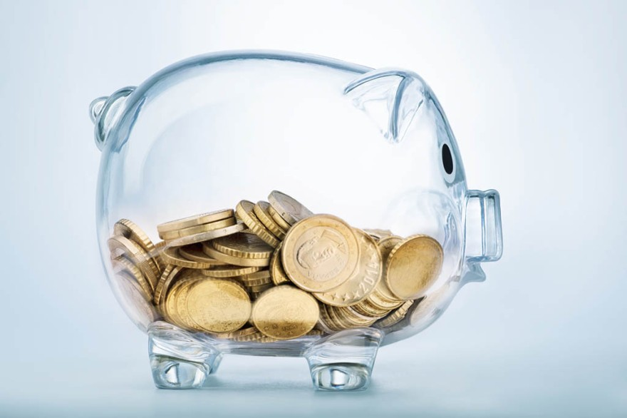 Seeing through piggy bank with money coins