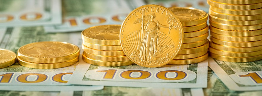 Stack of golden eagle coins on new design of US currency one hundred dollar bills with spotlight on the Liberty statue on one coin. Sized for cover photo image on popular social media site